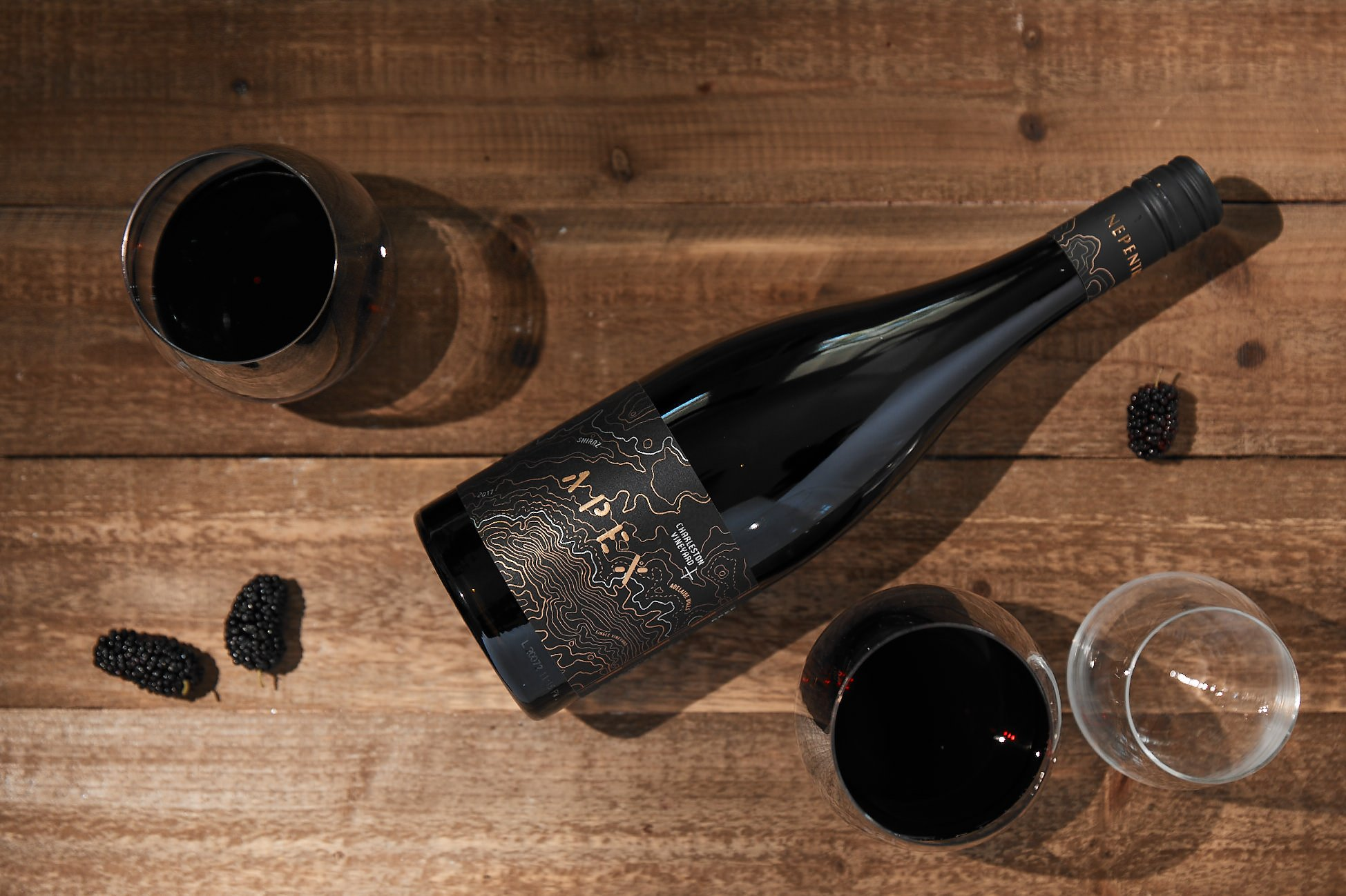 Nepenthe Apex shiraz on a brown table